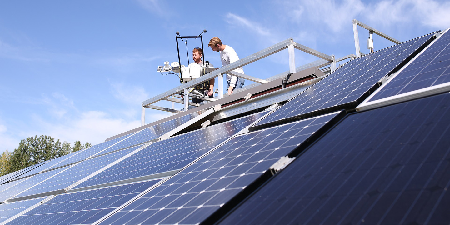 STEP team members work on solar panel